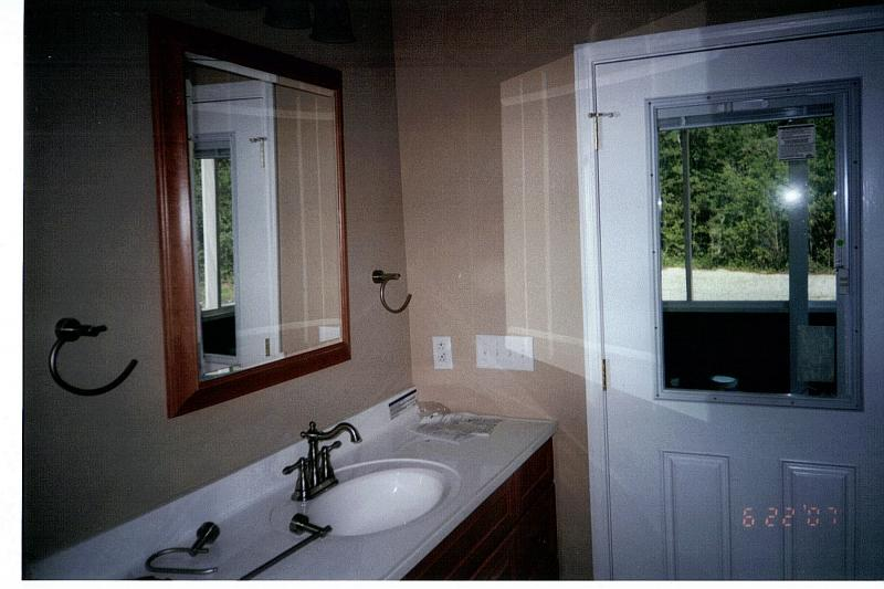 Master bath with door to rear screen porch